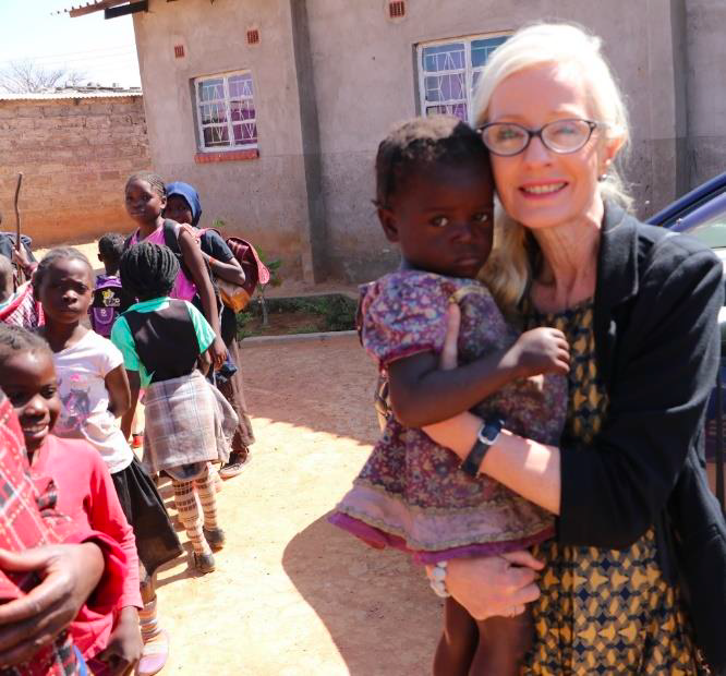 Teresa in Zimbabwe with a children's class.