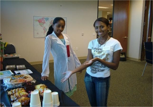 Two students present a buffet of food.