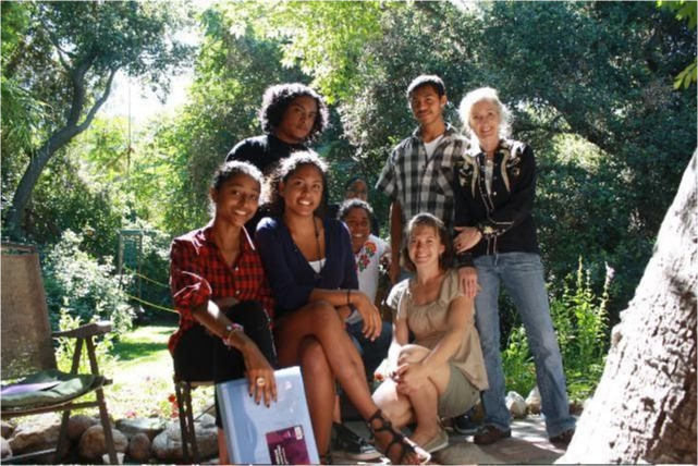 A group of six students and Teresa outside in nature.