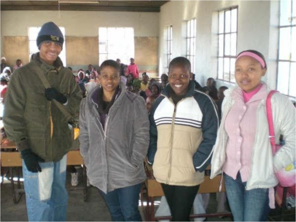 Sonny Douglas with students in Lesotho.