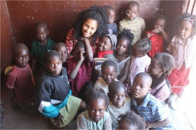 Jade Romain with students in Zambia.