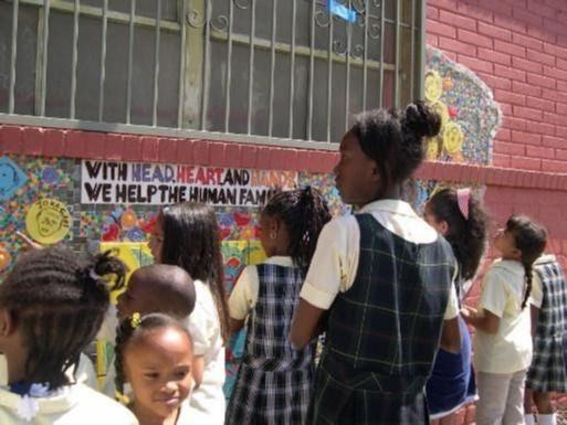 Children read the mural
