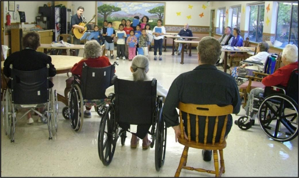Grandparents watch a class presentation
