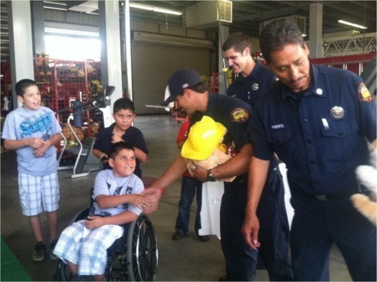 Firefighters meet with students at the fire station