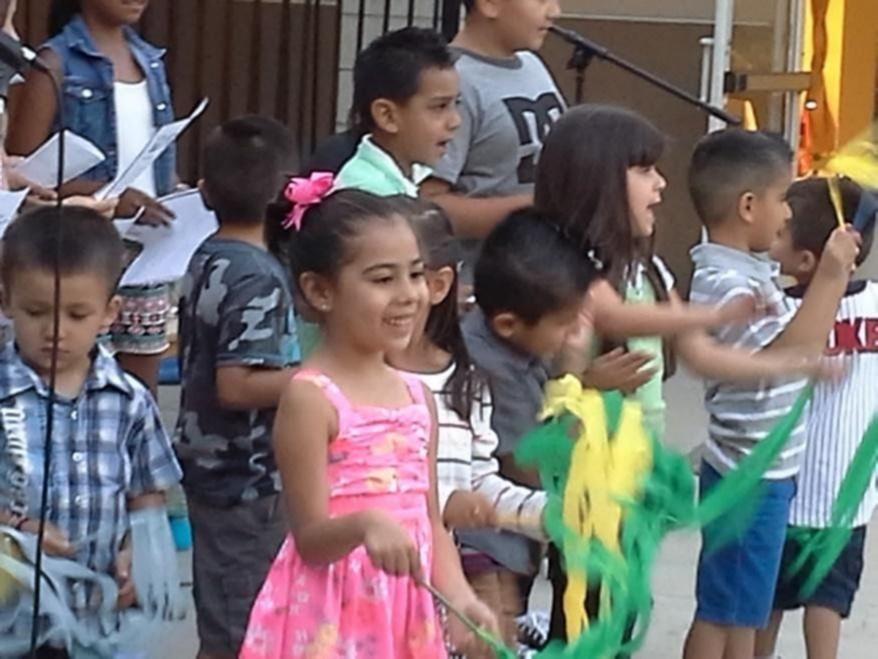 Children waving streams from sticks