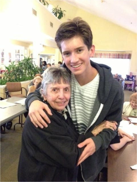 A senior resident cherishes an adopted grand-child.