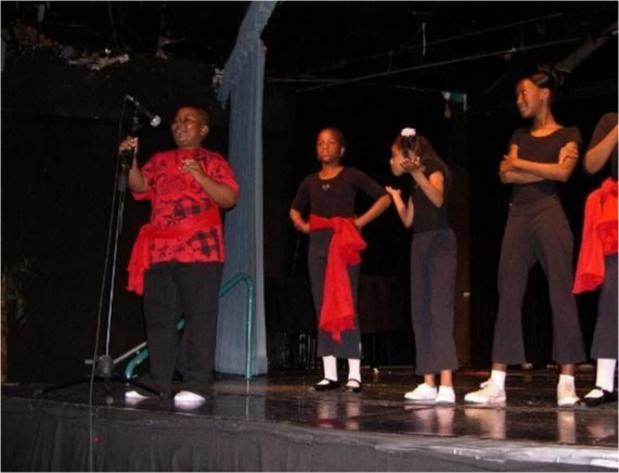 Students perform on stage.