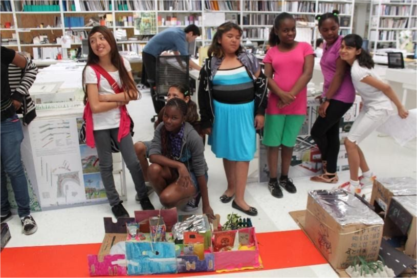 Students gather next to their projects.