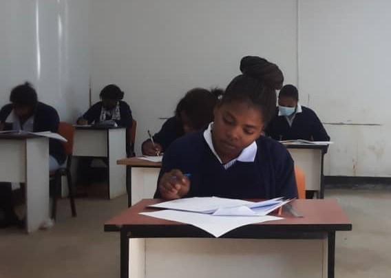 Gambian children at their school desks.