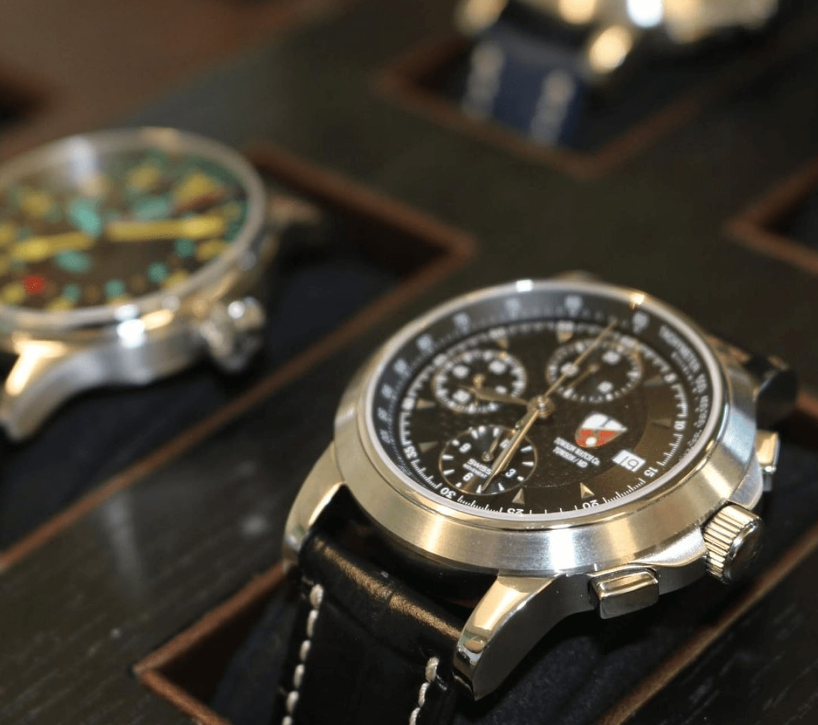 Decorative shot of some Towson Watch Company watches in cases.