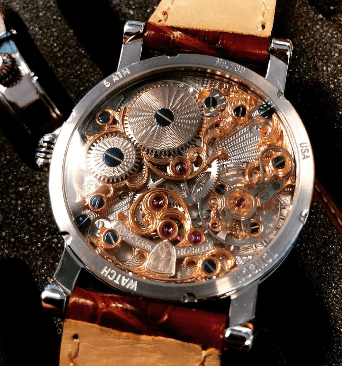 Back side of a Towson watch showing the mechanical parts.