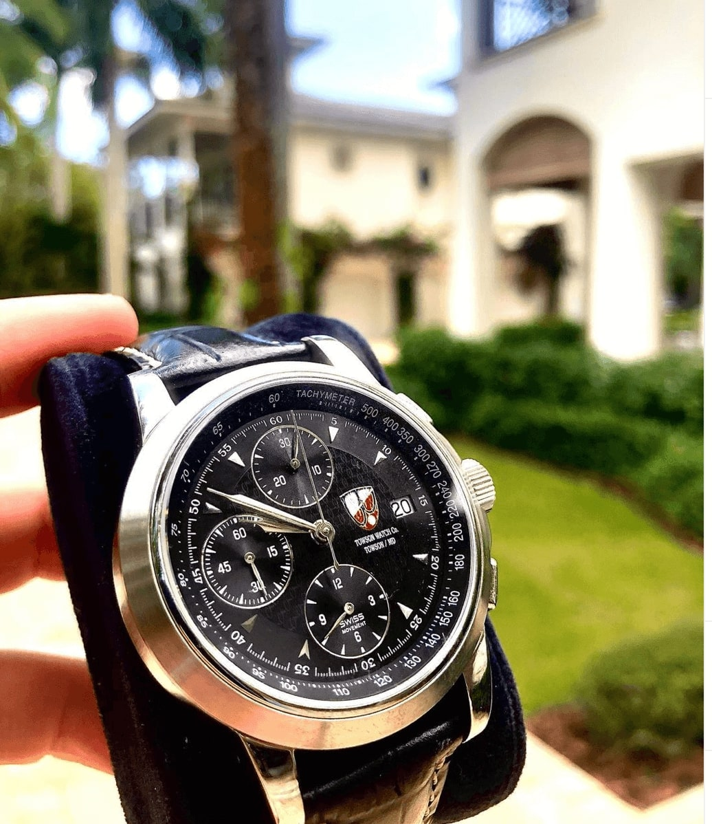 A Towson watch with black band and black dial.