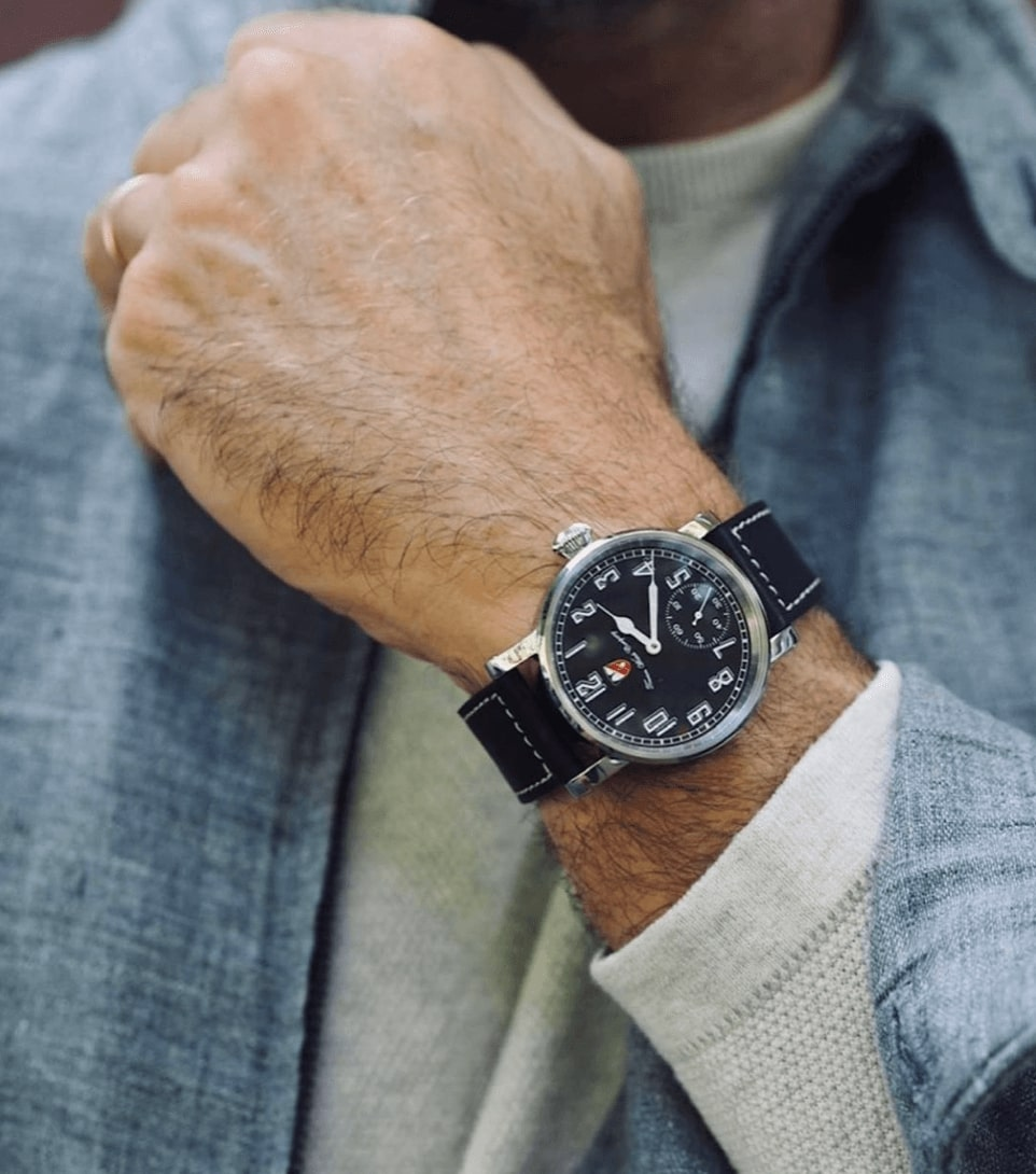 A Bay Pilot from Towson Watch Company on a casually dressed man.