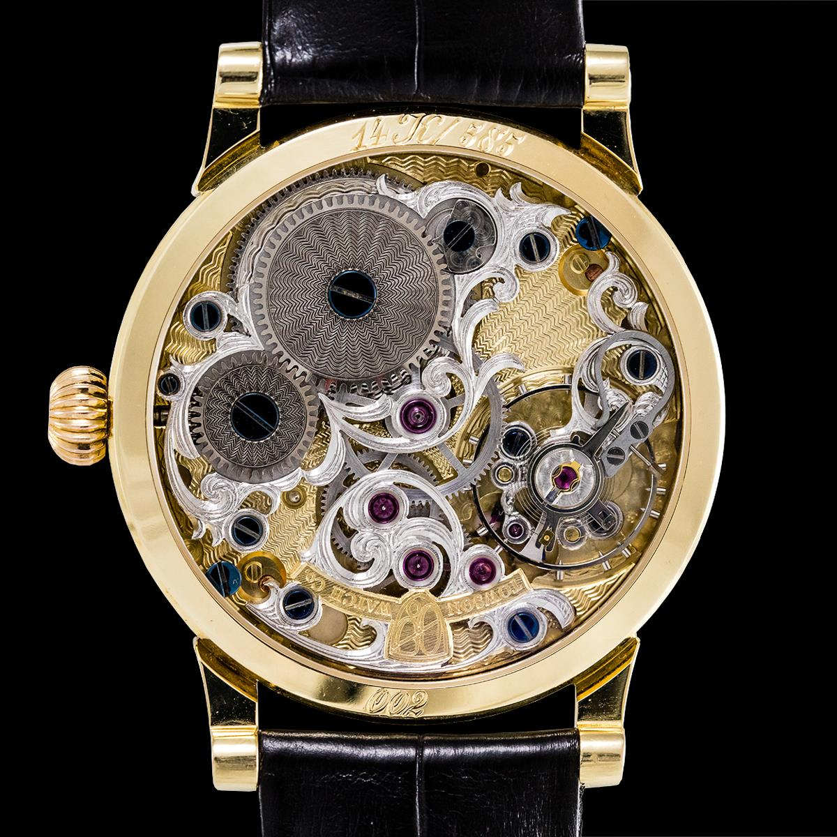 Master watchmaker George Thomas of Towson Watch Company inspecting his work.