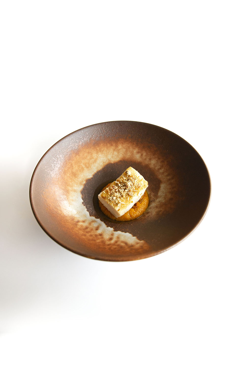 White fish in a bronze bowl