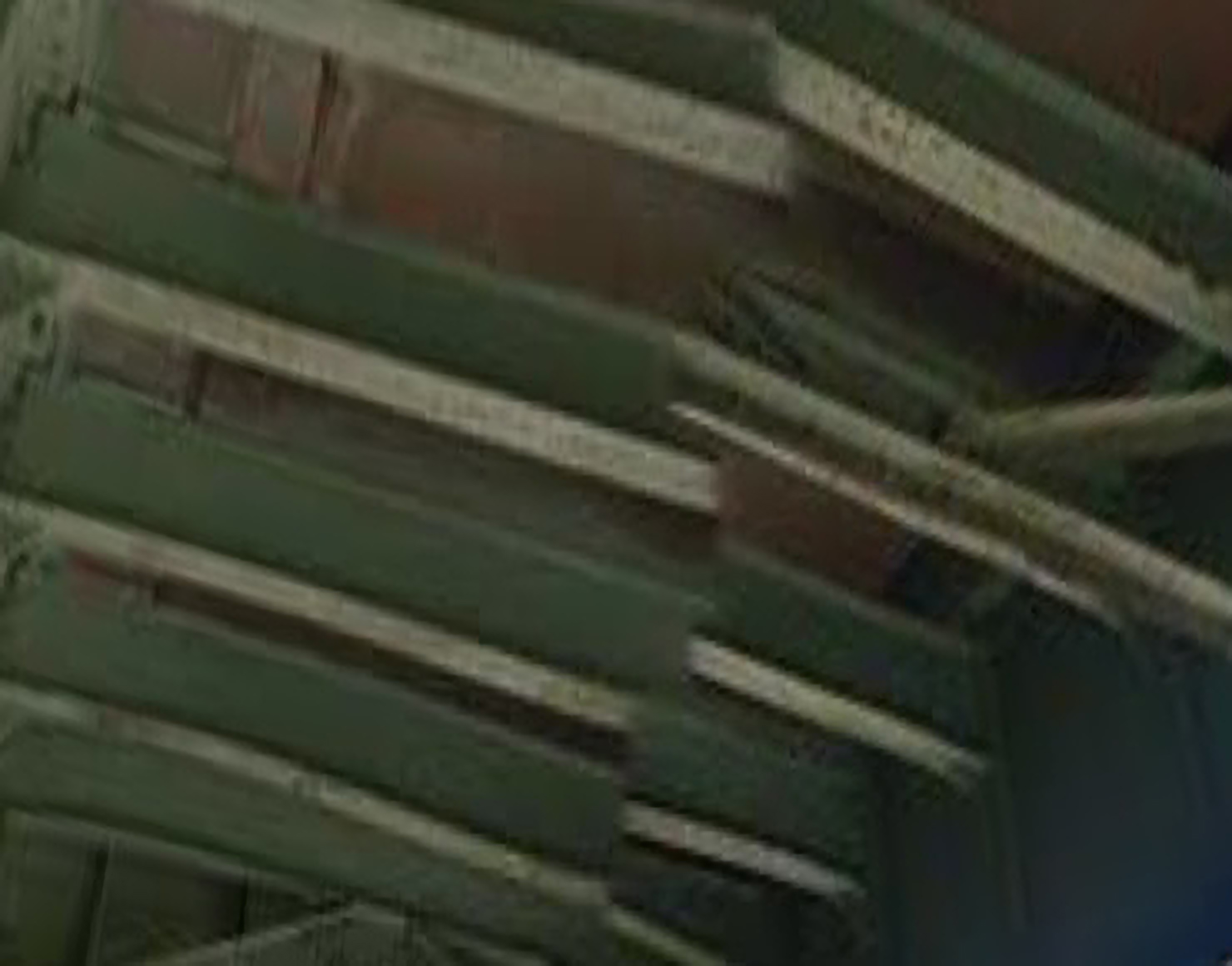 An abstract photograph of the underside of a bridge, consisting of cement held up by light-green girders. A Google Street View panorama artifact cuts the image into two.