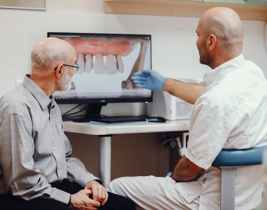 Dentist explaining dental implants and bone loss