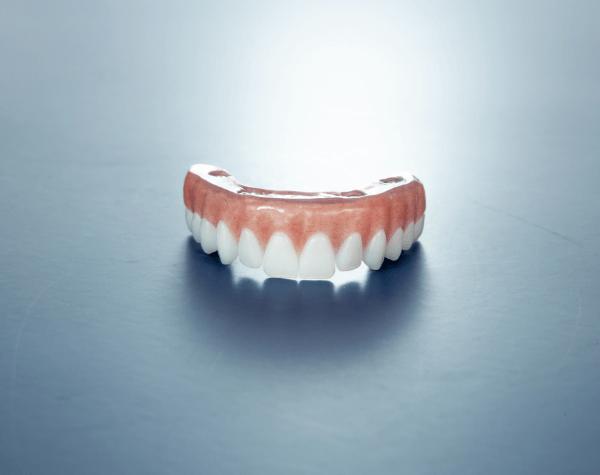 Dental Implant Surgeon Showing Teeth Scan