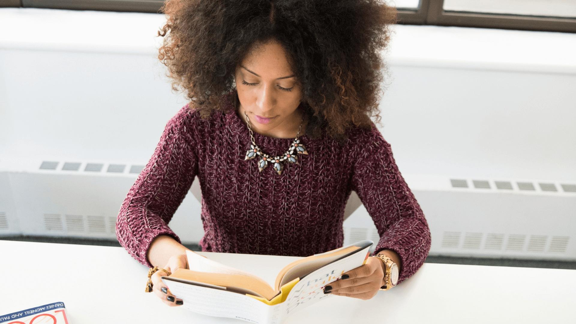 A black woman reading a book