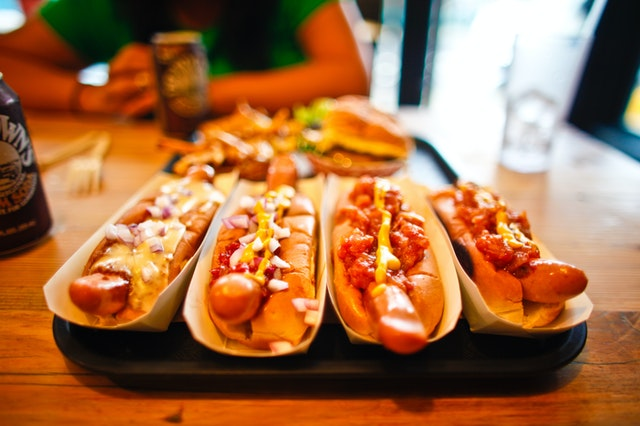 four hot dogs side by side
