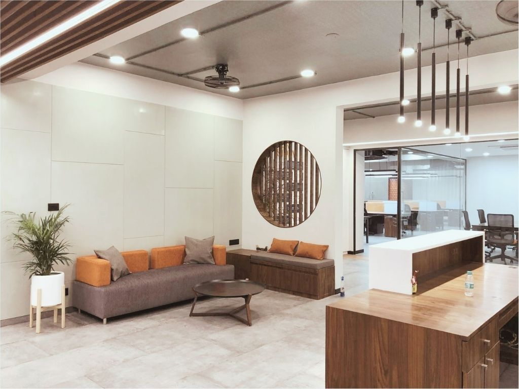Office casual seating area with back paneling