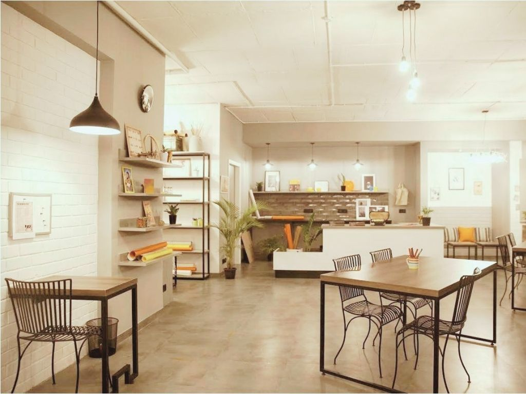 Co working office space interiors with table and drop lights