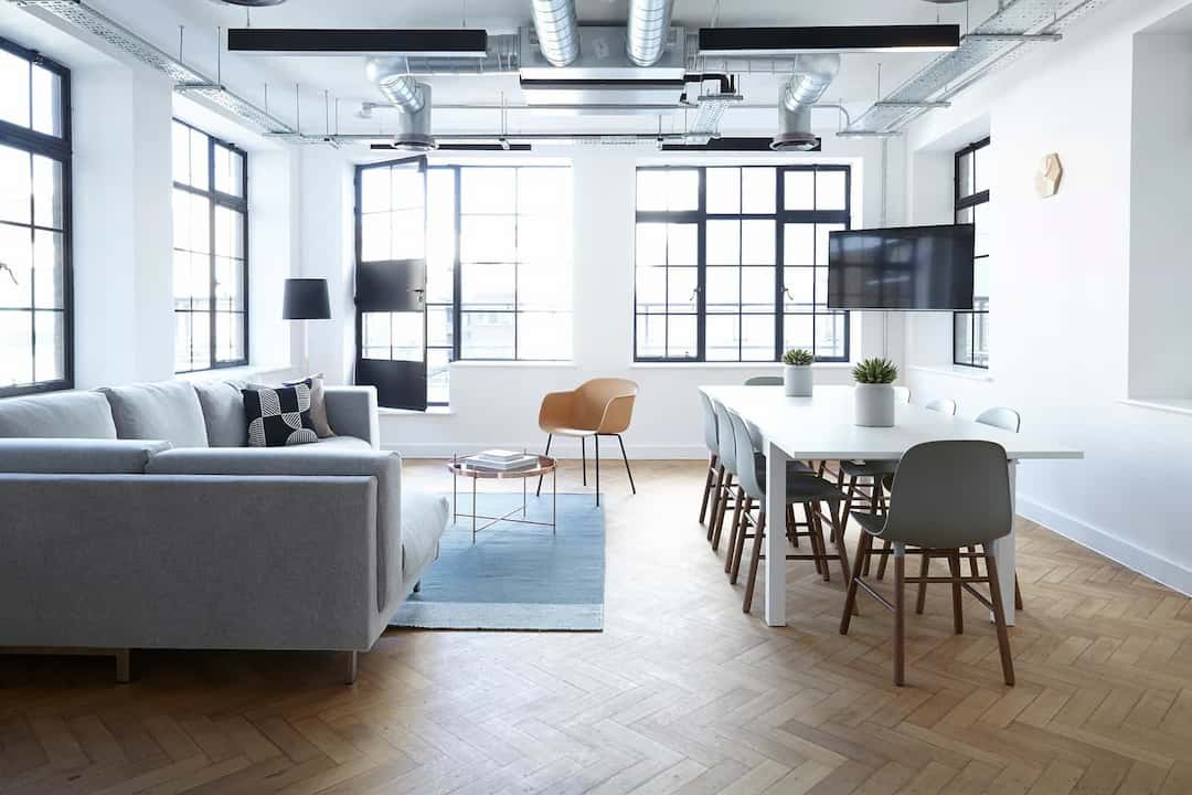 office space view with wood flooring and sofa