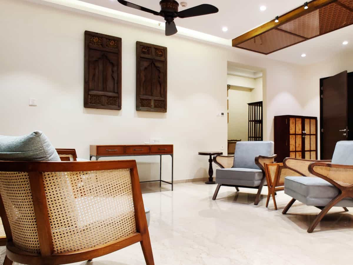 Teak wood furniture designed for the living room with wall decorated with solid wood panels