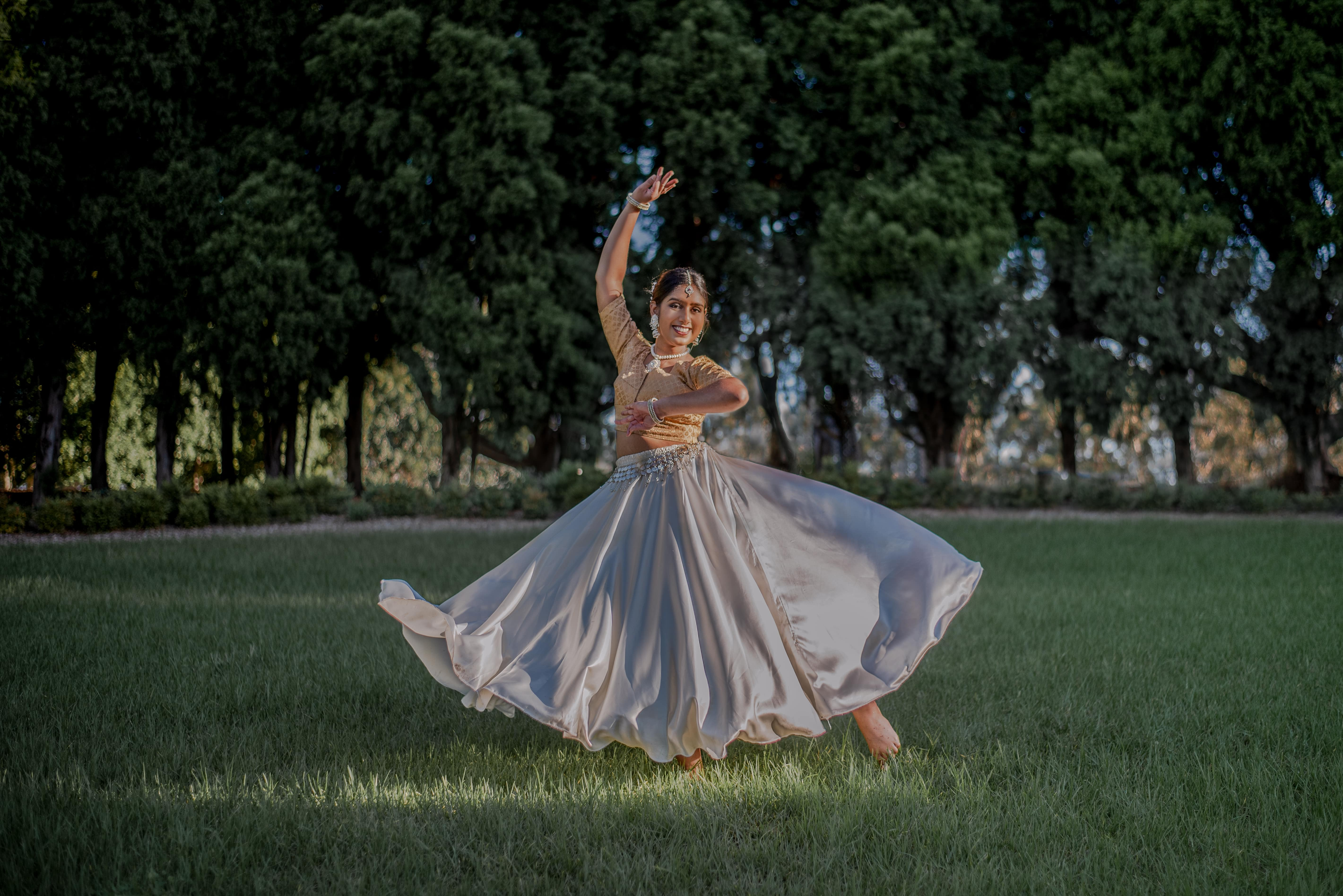 girl in indian clothes in dance pose