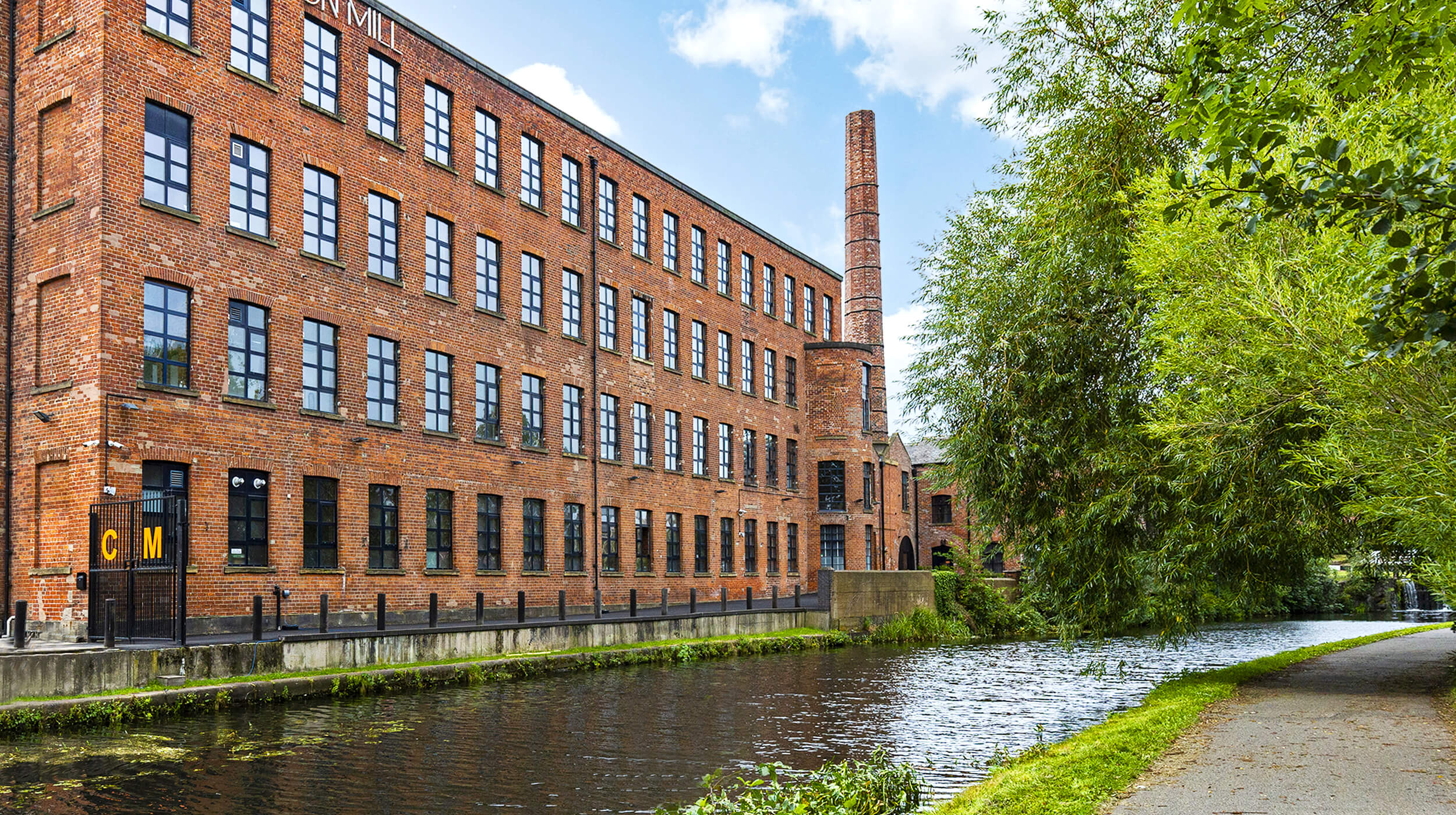 Canal side view of Castleton Mill on the Leeds Liverpool canal