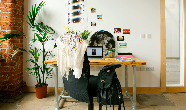 Desk setup in a studio workspace at Castleton MIll in Leeds