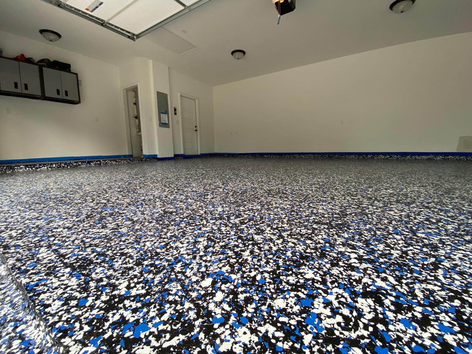 Is it worth it to epoxy flake garage floor