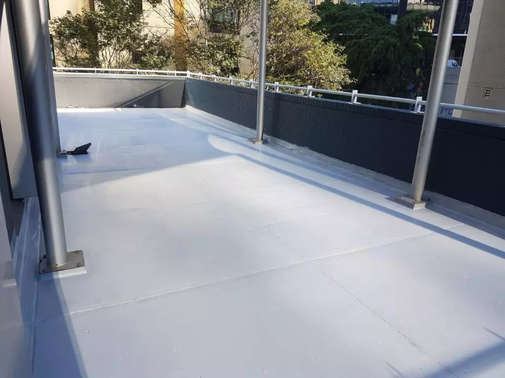 What is the Australian Standard requirement for vertical termination height of external waterproofing?