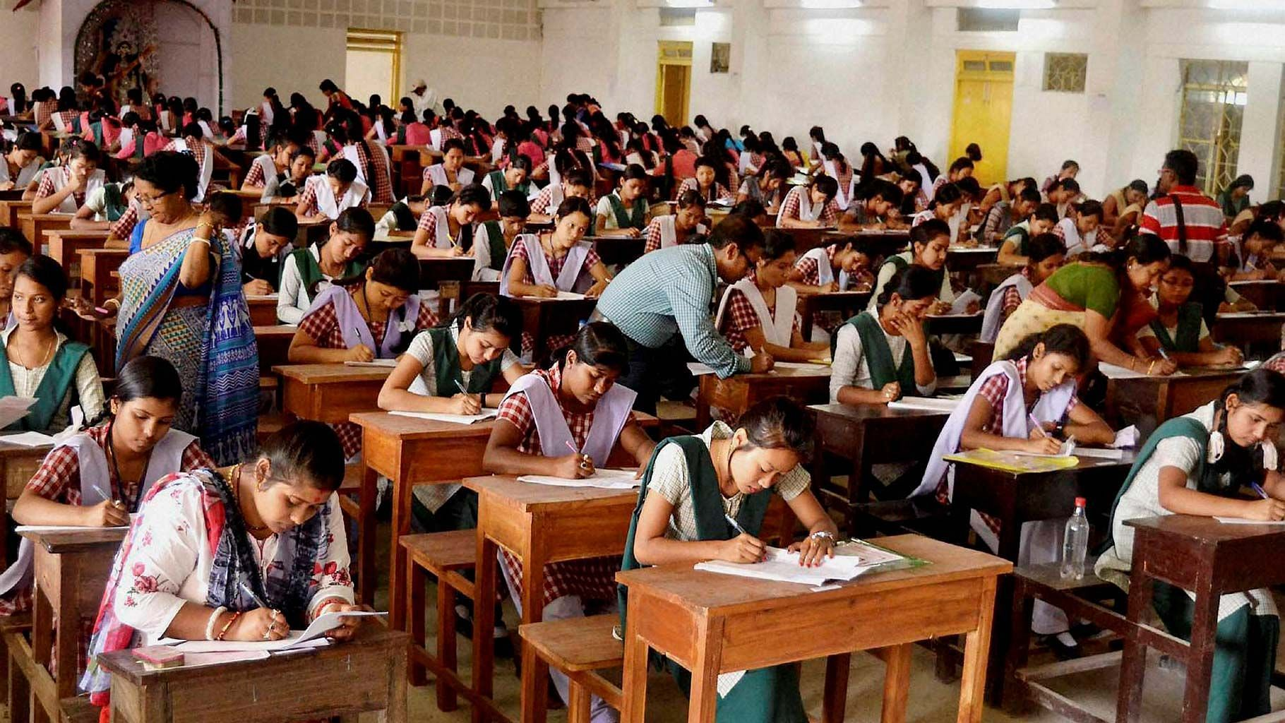 Image of students writing an exam