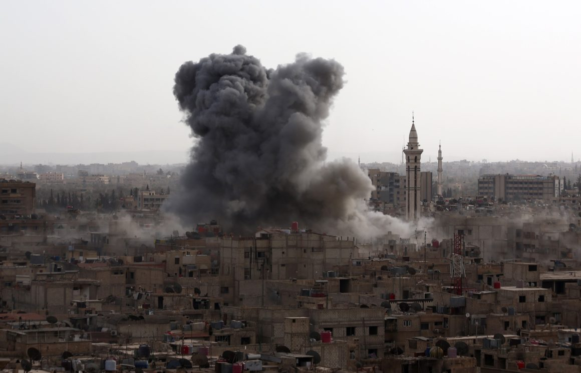Image of smoke from an explosion in a city in Syria