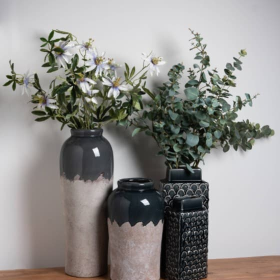 3 vases with artificial flowers