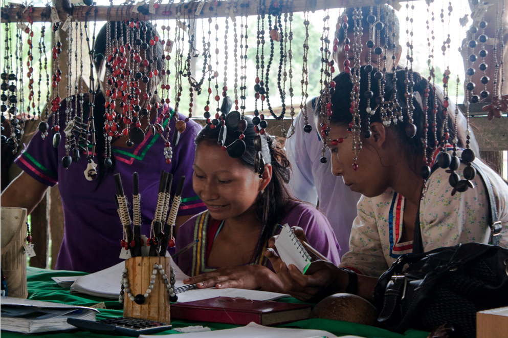 Women in Sani Isla meeting in 2017 to design handicrafts for sale