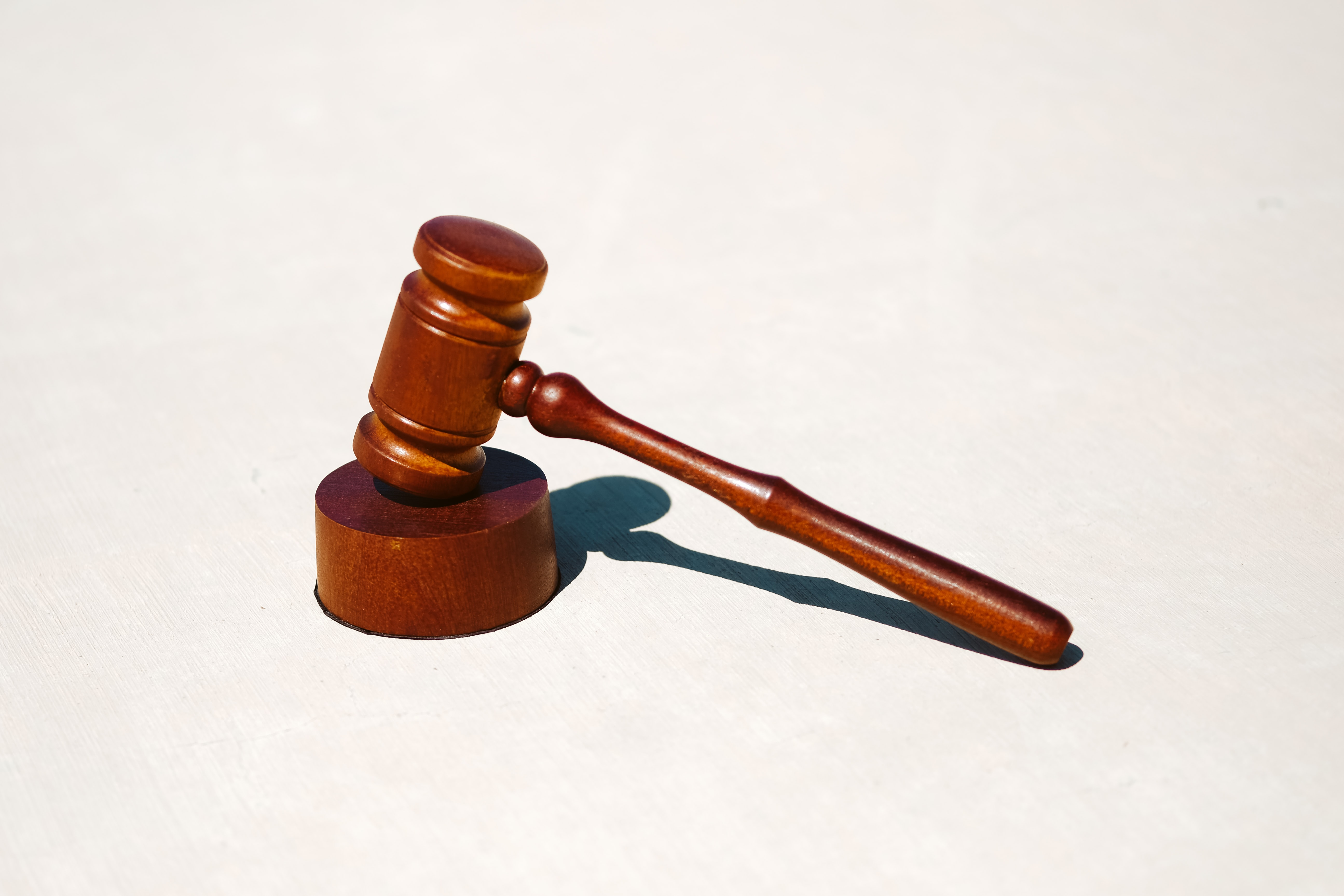 A wooden gavel and block on a white background
