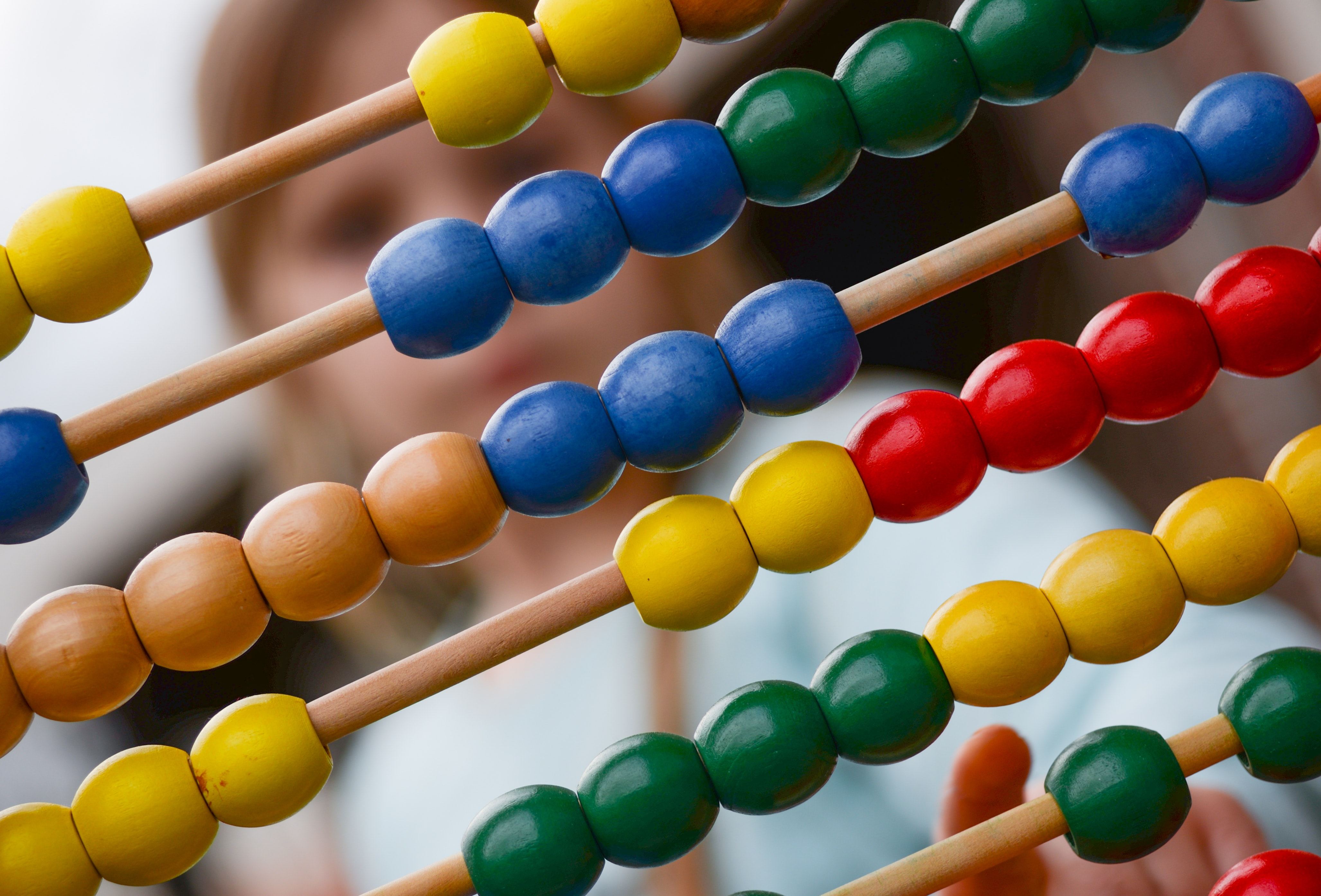 Variety of colourful beads on an abacus