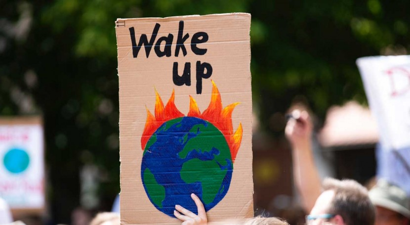 'Wake up' protest placard of world burning