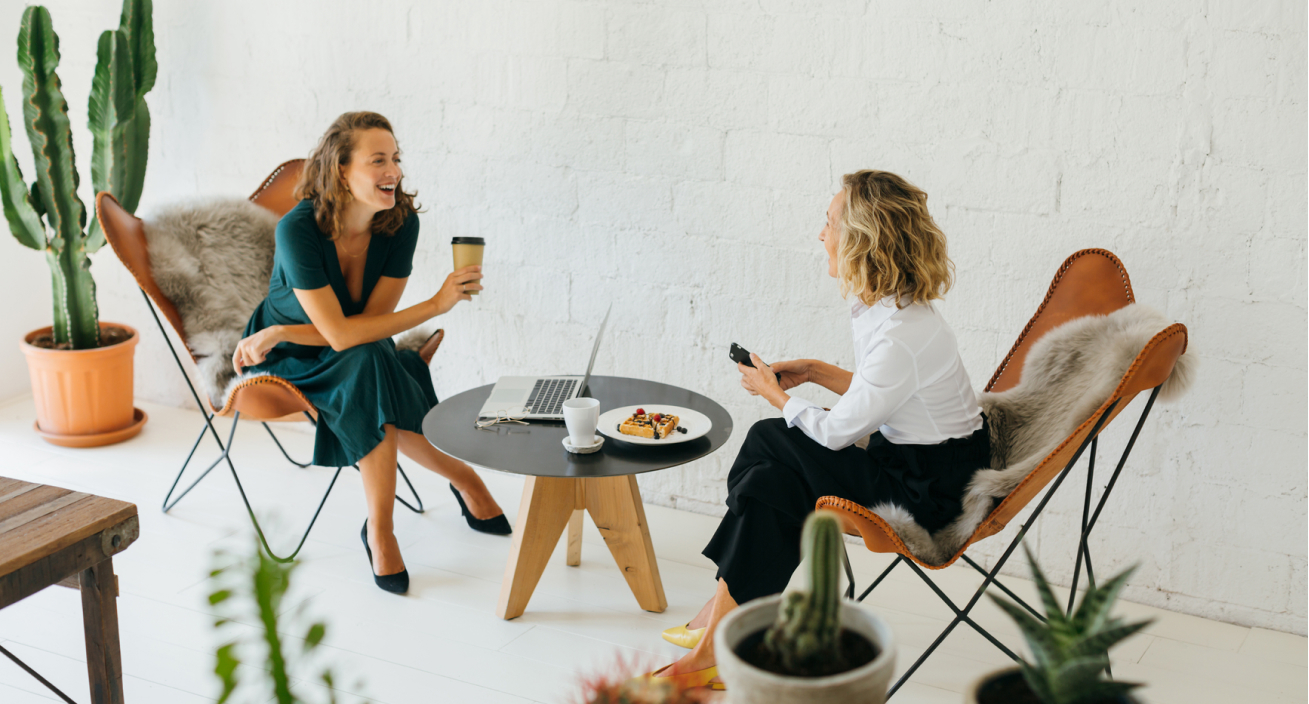 Two woman having a lively conversation in an office
