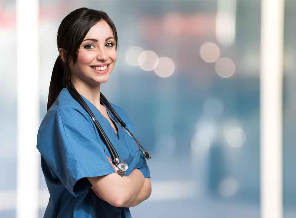woman in scrubsuit smiling