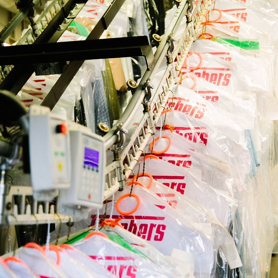 Fletchers Fabricare conveyor with clothes
