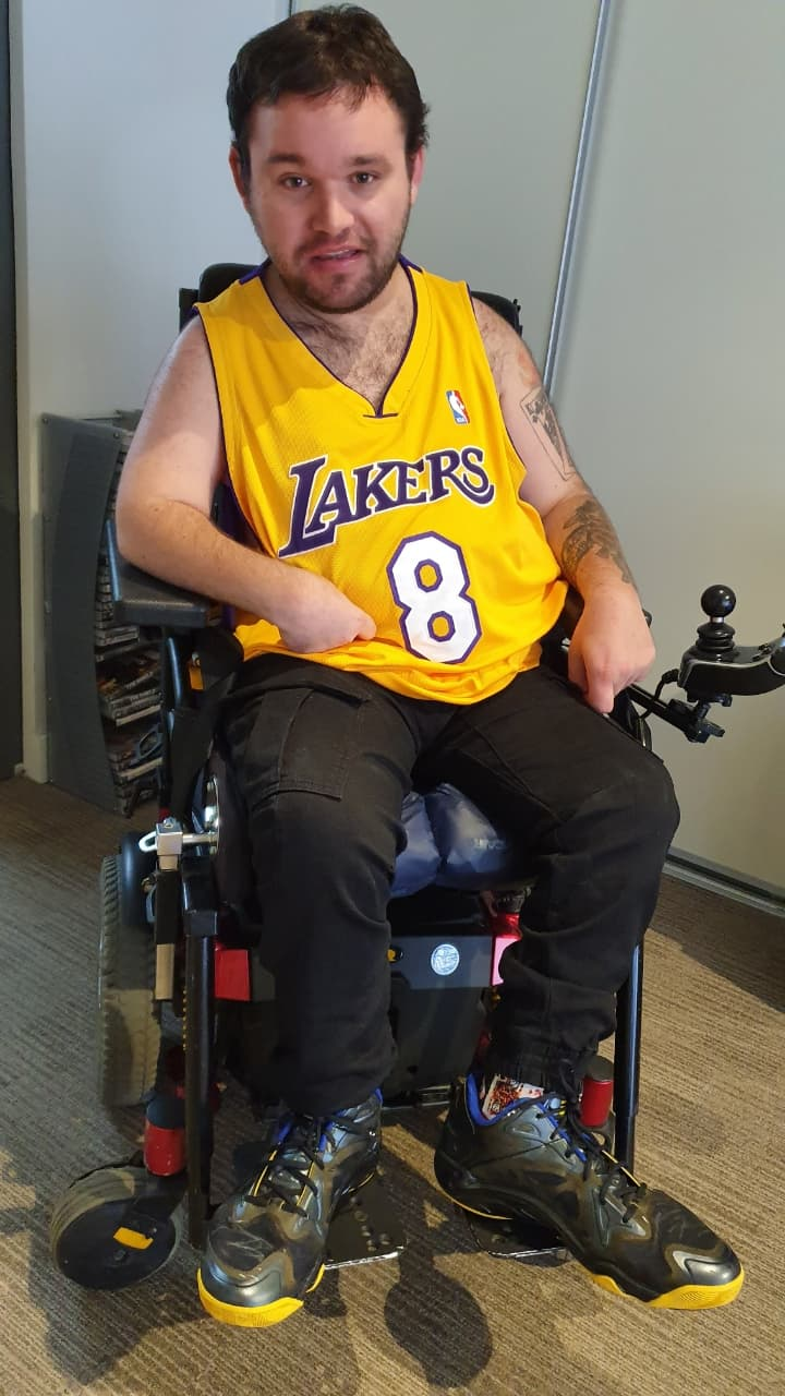 Image description: Jono pictured in Kobe Bryant's old jersey and sneakers on the day of his death..
