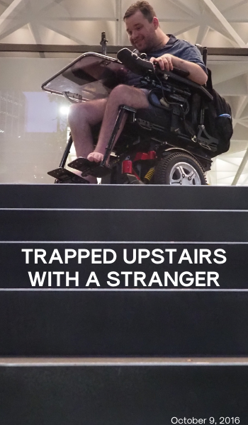 Blog: Trapped upstairs with a stranger. Image description: A photo of Jono in his wheelchair on a landing above a set of stairs.