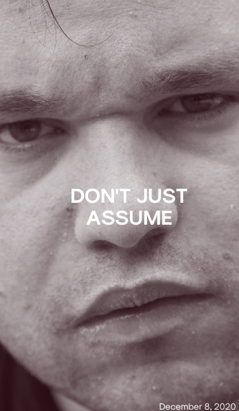 Blog: Don't just assume. Image description: A close up photo of Jono's face. He has a stern look on his face. The image is in black and white.