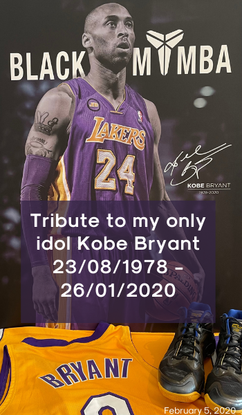 Blog: The Black Mamba. Image description: A canvas with a photo of Kobe Bryant. A pair of Kobe Bryant's shoes and his Laker's jersey are sat in front of the canvas.