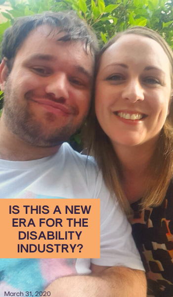 Blog: Is this a new era for the disability industry? Image description: A photo of Jono and a woman. They are both smiling in front of some trees.