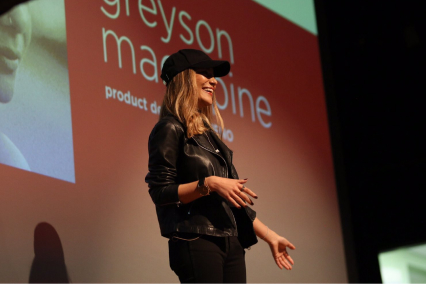 Greyson speaking at conference