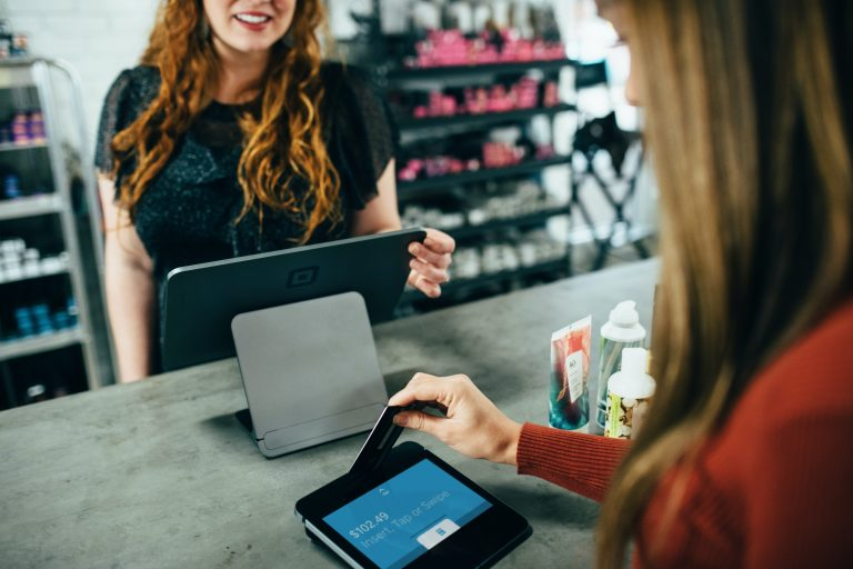 smiling customer checking out with credit card